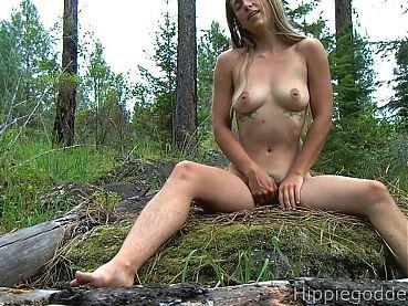 Hairy girl masturbating in nature