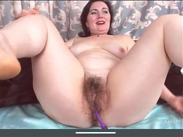 Granny passionately and fully nude plays with hairy pussy